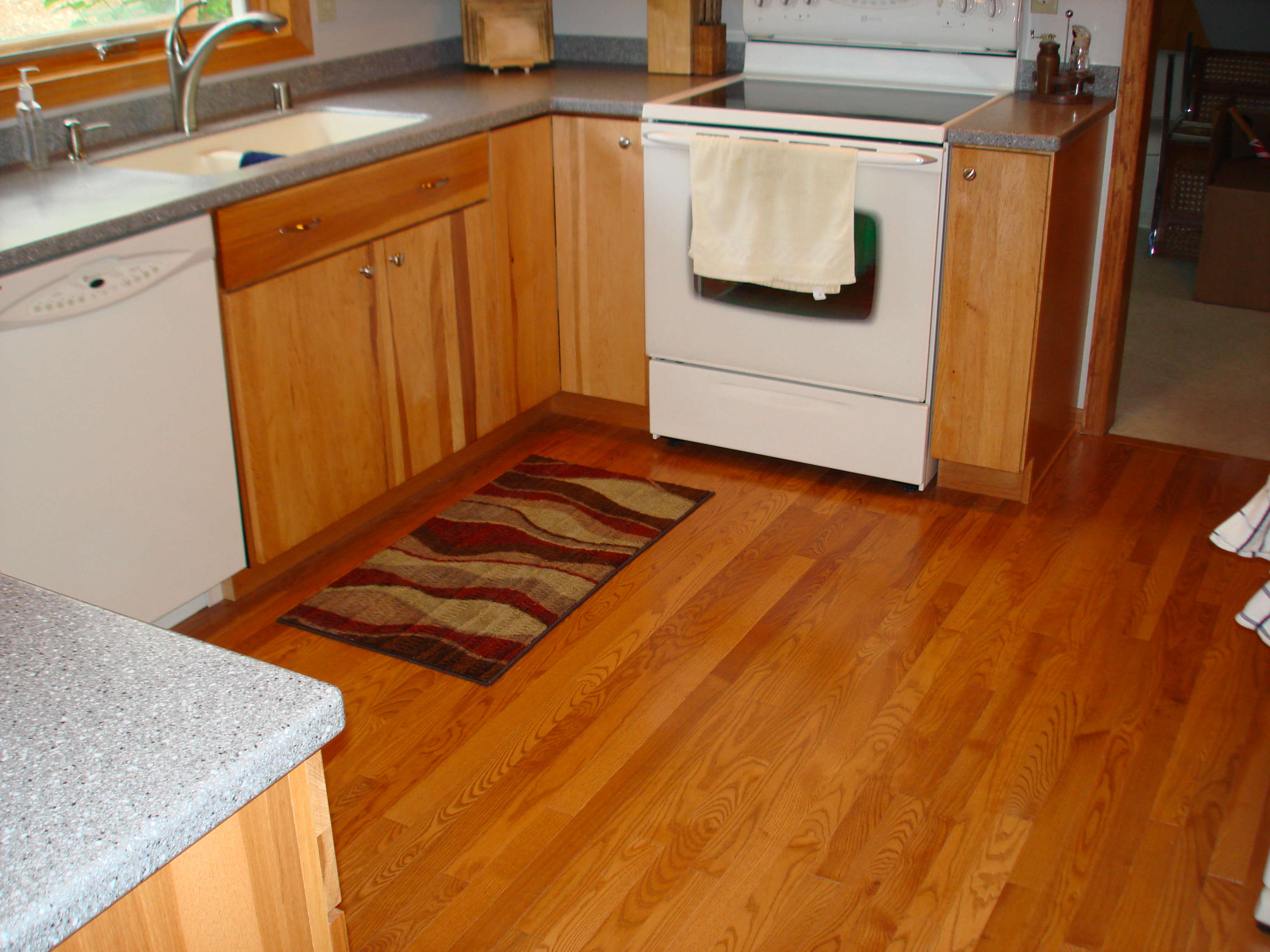 Flooring becker home improvement for Wood floors in kitchen